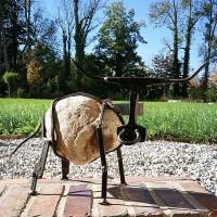 WAGGÄ - Stier aus Flussstein und Stahl